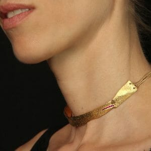 Skin-textured choker. gold plated sterling silver with rubies.